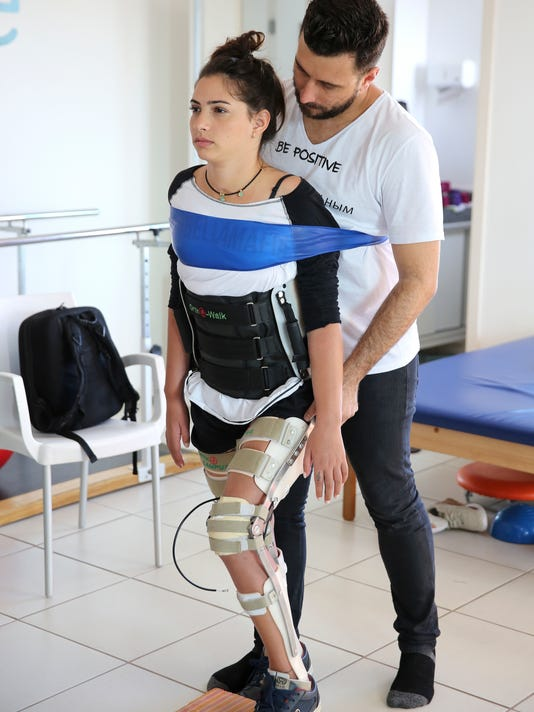 In this Feb. 1, 2018 photo, Lais Souza attends a physiotherapy session, in Ribeirao Preto, Brazil. The 29-year-old former Brazilian gymnast found herself paralyzed from the neck down after hitting a tree head on, during a freestyle ski practice in Utah for the 2014 Winter Olympics. (AP Photo/Andre Penner)