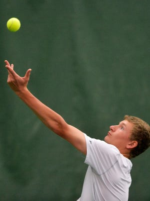 Great Falls Central's Nick Scott serves to Trey Christiaens of Valley Christian in Friday's semifinals of the Class B-C State Tennis Tournament. Nick helped the school win its first state championship since 1962 this weekend.