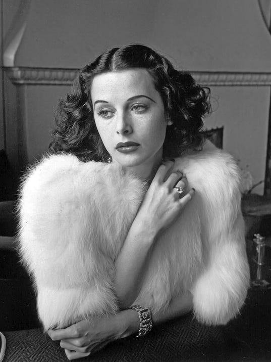Hedy Lamarr - Glamorous portrait of movie actress Hedy Lamarr wearing white fox fur short jacket.193