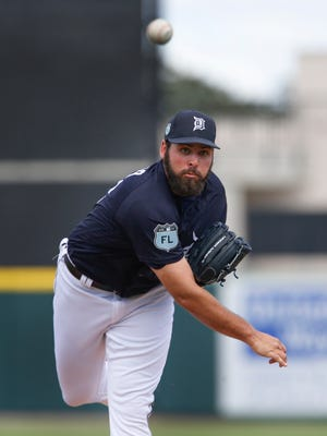 Feb 24, 2017; Lakeland, FL, USA; Detroit Tigers starting pitcher Michael Fulmer throws a warm-up pitch before the first inning of a spring training game against the Baltimore Orioles at Joker Marchant Stadium.