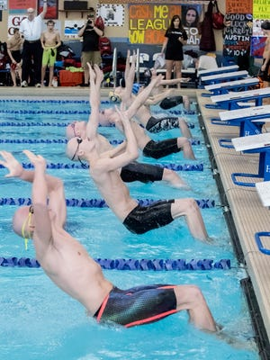 Swimmers at the start of the 200 Yard Medley Relay during the 2017 SCC Men's Swimming and Diving Championships.