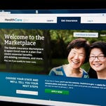 A woman looks at the HealthCare.gov insurance exchange internet site in this Oct. 1 file photo in Washington, DC. Indianapolis residents who look at the site might realize that their plans cost more than the plans offered to residents in other areas of the state. (Karen Bleier / AFP/Getty Images)