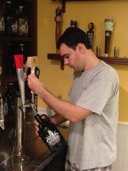 Bruno Tortoreti, beer manager at Beach Liquors, fills