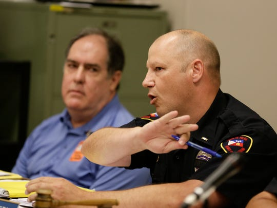 Board member Guy LeBreton, right, replies to public comments during a meeting of the Lafayette Fire and Police Civil Service Board May 18, 2016.
