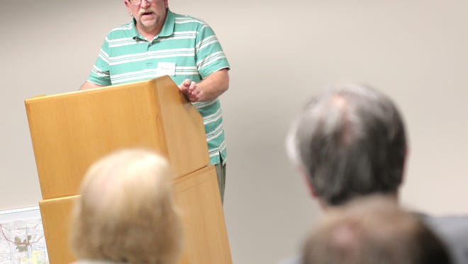 Community advocate Bill Baker addresses a crowd in the Richland County Library about fracking plans.