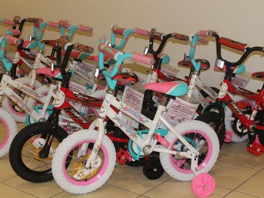 Desert sun toyota to give away bikes to chins children for Desert sun motors alamogordo