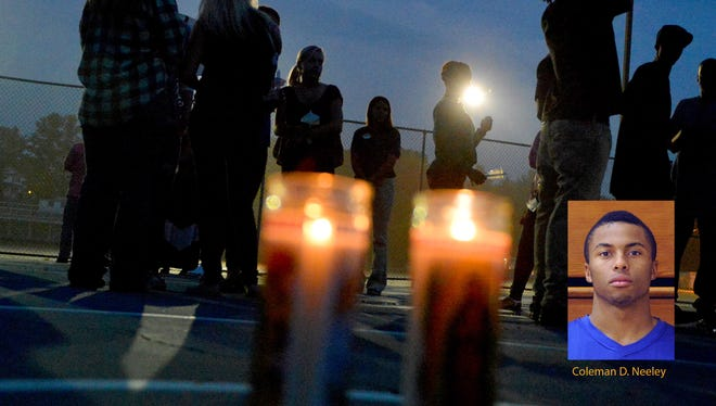 People gather on the basketball courts at Gypsy Hill Park for a vigil for Coleman D. Neeley on Tuesday, Aug. 19, 2014. Neeley was killed in a shooting August 16, 2014 in Fort Defiance.