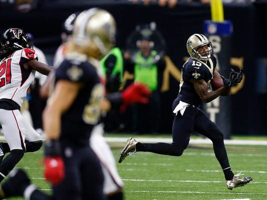 Atlanta Falcons wide receiver Andre Roberts (19) pulls in a touchdown reception in the first half of an NFL football game against the Atlanta Falcons in New Orleans, Sunday, Dec. 24, 2017. (AP Photo/Butch Dill)