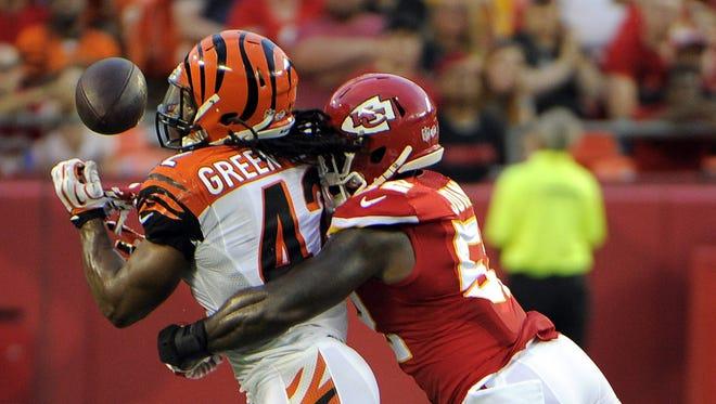 Kansas City Chiefs linebacker James-Michael Johnson (52) defends against Cincinnati Bengals running back BenJarvus Green-Ellis (42) in the first half at Arrowhead Stadium.
