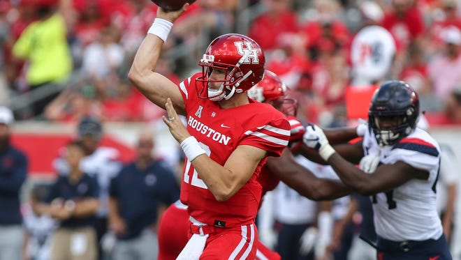 Sep 8, 2018; Houston, TX, USA; Houston Cougars quarterback Quinten Dormady (12) attempts a pass during the second quarter against the Arizona Wildcats at TDECU Stadium. Mandatory Credit: Troy Taormina-USA TODAY Sports