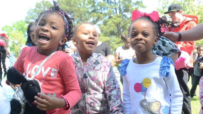 Harmonee Bradley (left), Brae Gaines and Brooklynn Baylor participate in an Easter dance off Saturday by Pineville Concerned Citizens Inc., and the Phi Gamma Omega chapter of Alpha Kappa Alpha sorority. Harmonee won in her girls' age group.