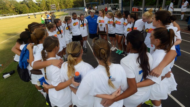 West Florida's head coach Joe Bartlinski chats with his team Sunday after winning the 2016 Gulf South Conference Women's Soccer Championship by beating Mississippi College 2-0 at the UWF Soccer Complex.