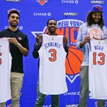 From left, New York Knicks' Courtney Lee, Brandon Jennings and Joakim Noah pose for photos with head coach Jeff Hornacek during a news conference at the team's training facility, Friday, July 8, 2016, in Greenburgh, N.Y. (AP Photo/Julie Jacobson)