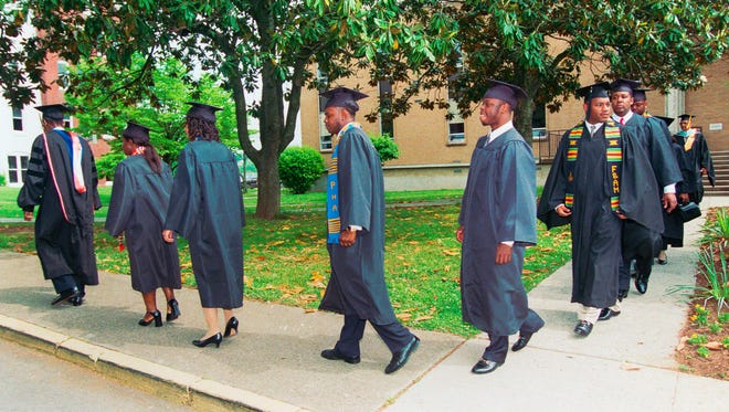Professor Jesse James, far left, leads the school's eight graduating seniors to the commencement ceremony in the James A. Colson Center on Saturday, May 13, 2000, at Knoxville College. (NEWS SENTINEL ARCHIVE)