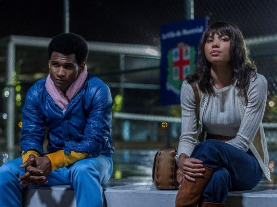"""This image released by The Weinstein Company shows Usher Raymond, left, and Jurnee Smollett-Bell in a scene from, """"Hands of Stone."""" (Rico Torres/The Weinstein Company via AP)"""