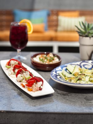 Host a party with no-cook dishes. From left: Crab stuffed peppers, sangria, grape salad and zucchini carpaccio.