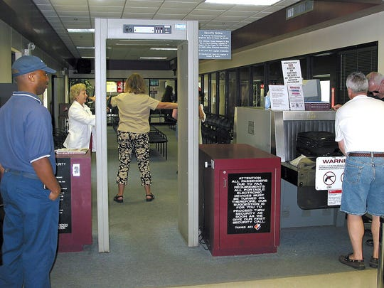 Stricter security measures went into effect at Alexandria International Airport and other airports around the country following the Sept. 11, 2001, terrorist attacks.  -9/10/2002 A1 Passengers flying out of Alexandria International Airport must walk through a stationary metal detector and are then searched with a hand-held metal detector. Tighter security measures enacted after the Sept.11 terrorist attacks are still in effect. - Leandro Huebner/The Town Talk