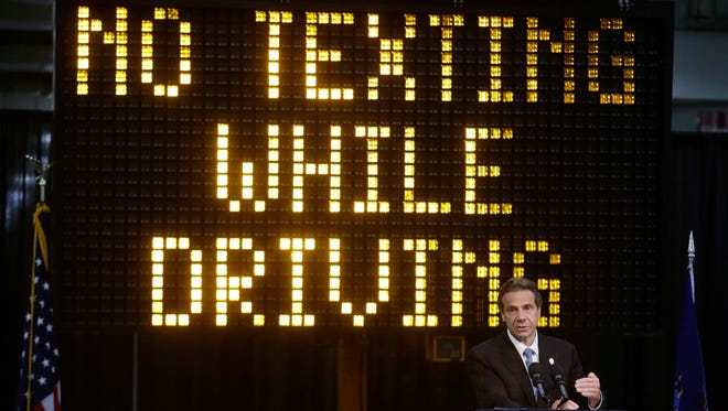 In this May 31, 2013 file photo, New York Gov. Andrew Cuomo speaks during a news conference to announce the increase in penalties for texting while driving in New York.