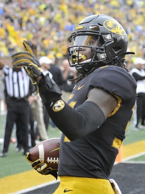 Missouri's Larry Rountree (34) signals upward after reaching the end zone against Troy on Saturday.