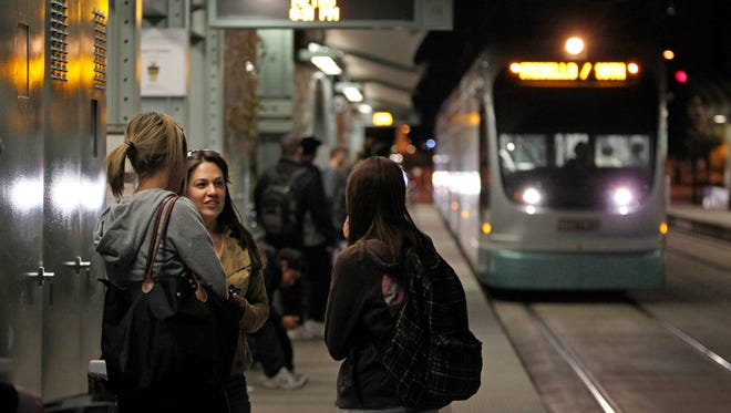 ASU students Megan McDonald, Carisa Cieri and Brittany Miller prepare to board a light-rail train in 2012. One-third of transit riders are students.