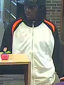 Lansing police have released images to two suspects in a Wednesday afternoon bank robbery.