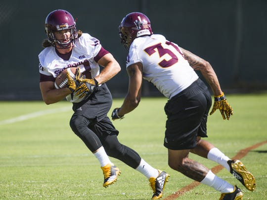ASU's Demonte King (left) tries to elude Marcus Ball during practice on July 26.