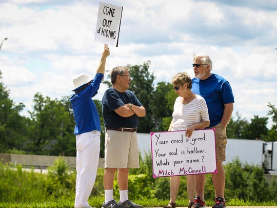 Nearly 100 people protest Affordable Care Act repeal in front of U.S. Sen. Mitch McConnell's offices in Fort Wright, Kentucky Monday, June 26, 2017.