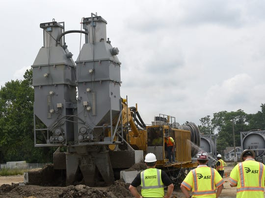 A DeWind One-Pass Trencher makes a test section of the future dam wall near Buckeye Lake State Park and Liebs Island.