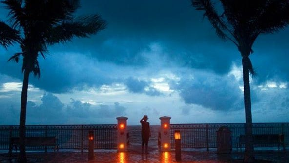 """""""I wanted to see the last sunrise before the hurricane hit and just feel the air before I'm closed in for the next couple of days,"""" said Kristen Brenan, of Vero Beach, who looks out over the Atlantic Ocean from Sexton Plaza in Vero Beach on Oct. 6, 2016."""