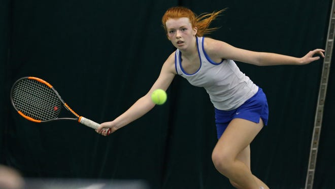 Webster's Catherine Gamble tracks her return as she faces Pittsford Sutherland's Josie Libby in the playback match.