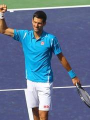 Novak Djokovic celebrates his victory over Milos Raonic