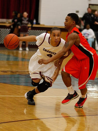 Jtown's Brandon Marshall drives to the bucket.  The defender is unidentified. February 26, 2014
