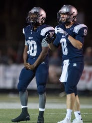 Reitz's Da'Ziaun Sargent (10) celebrates as the Reitz