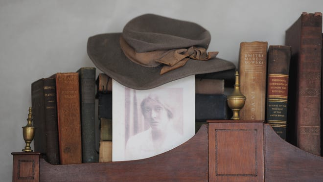 An image of Mary Heaton Vorse and her hat are placed among books in her former Provincetown home that was recently bought and restored by internationally known interior designer Ken Fulk.