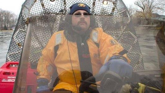 In this Feb. 3, 2012, photo, Hamburg Township Fire Department Deputy Chief Nick Miller navigates an airboat acquired by the department for ice and water rescues during a routine training session with fellow department firefighters.