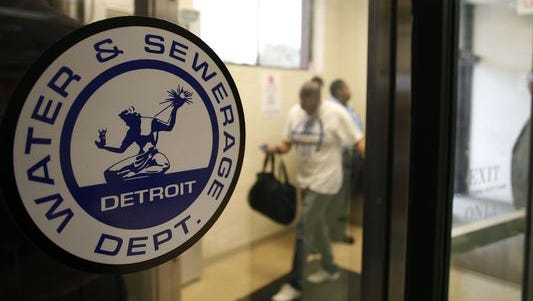 Detroit Water and Sewerage Department logo is displayed on a window as customers attend a Water Affordability Fair August 2, 2014, in Detroit.