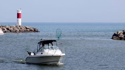 Boaters make their way into the  Irondequoit Bay outlet.