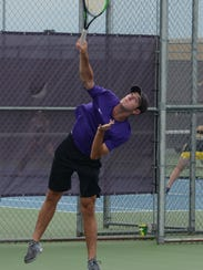Wylie's Lane Adkins serves during a doubles match against