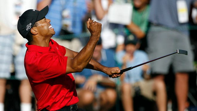 Tiger Woods celebrates after making a birdie on the 18th green to tie Rocco Mediate for the lead and force an 18-hole playoff at the final round of the 2008 US Open Championship at Torrey Pines.
