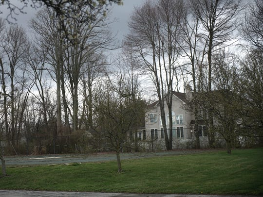 Neighboring homes can be seen by the old tennis courts