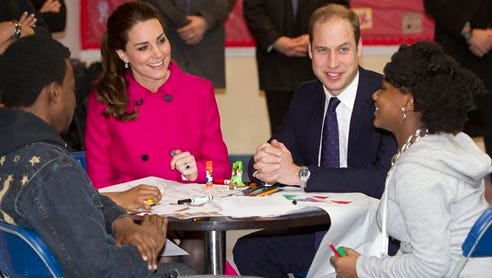 Britain's Prince William, Duke of Cambridge, right, and his wife Kate, Duchess of Cambridge, talk with students Nya Hayer, right, and Steffon Bell as they visit The Door today. The Door provides services to disadvantaged young people. William and Kate are on the last of their 3-day tour of New York City, their first visit to the United States since a trip to California in 2011.