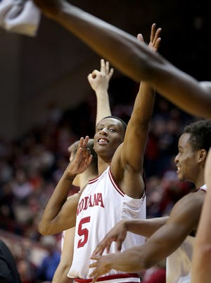 Hoosiers forward Troy Williams (5) and the rest of the bench celebrate a three-pointer late in the second half of their game Jan 19, 2016, at Assembly Hall in Bloomington.