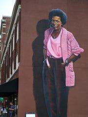 A 30-foot-tall mural depicting poet Mari Evans, painted