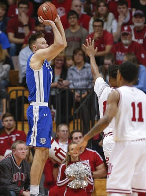 Fort Wayne Mastodons forward Dylan Carl (11) shoots a three pointer during the game against the Indiana Hoosiers at Simon Skjodt Assembly Hall on December 18, 2017 in Bloomington, Indiana. (Michael Hickey for The Star)