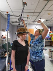 Registered nurse Manie Upton places 13-year-old Meredith Mozingo in traction to help straighten her spine before surgery at the Shriners Hospital for Children in Greenville.