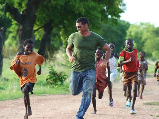 Gary Jasmund plays with children in a village in northern