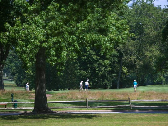 Golfers at the 13th hole of the DuPont Country Club.