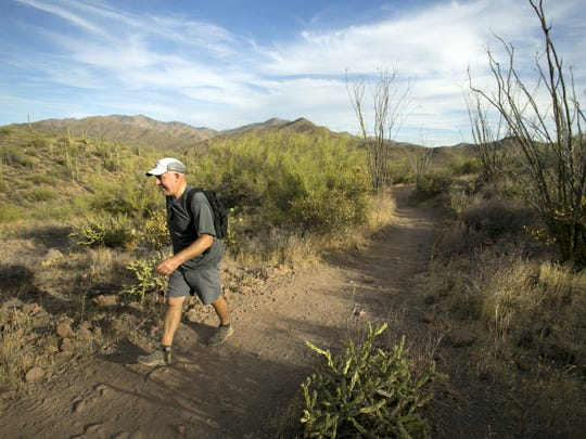 Robert Koby of Vancouver, Canada, hikes along the Spur Cross Trail in the Spur Cross Ranch Conservation Area outside of Cave Creek on November 14, 2017.