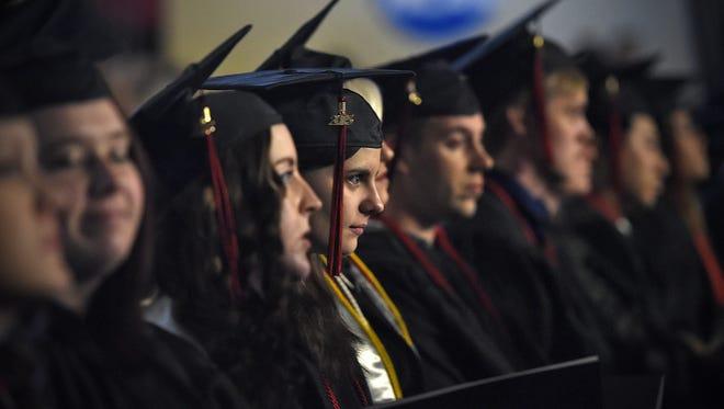 Graduates listen as university officials speak during fall 2015 commencement Dec. 18 at St. Cloud State University's Halenbeck Hall.