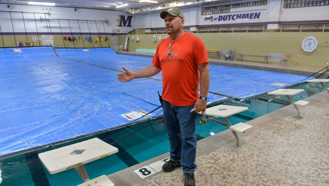 Melrose Area Schools Head Custodian Fran Hinnenkamp explains on Monday, May 23, that the current high school pool is too shallow for diving, has inadequate space for teams and spectators during meets, and has maintenance issues because it was built around 1970. A referendum in the district brings hopes for a new, eight-lane pool, among other improvements.